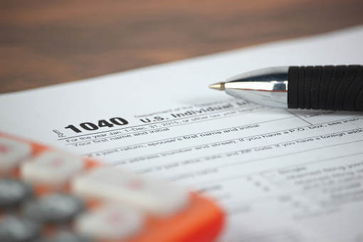 do you have to report your roth ira on taxes form 1040